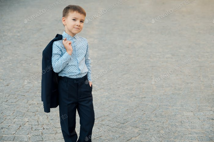 Portrait school boy posing in elegant clothes