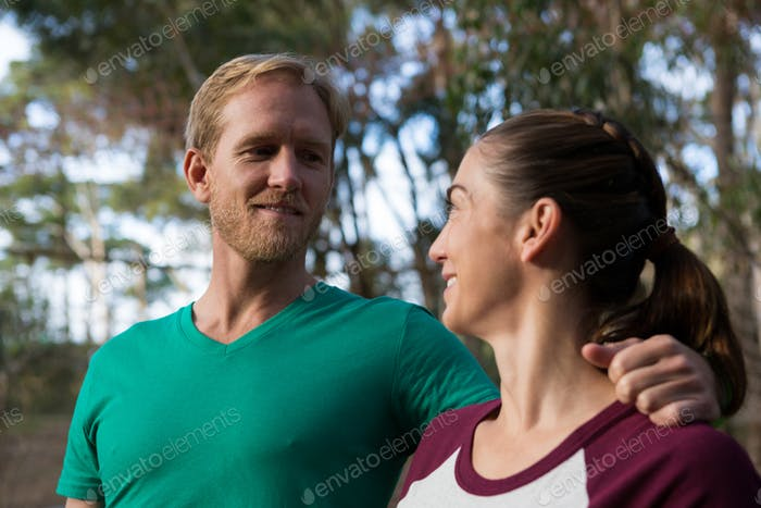 Woman and trainer looking at each other happily