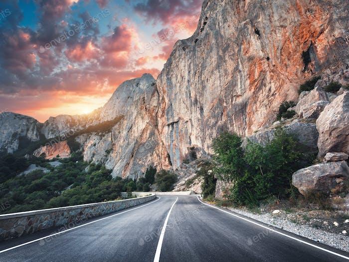 Beautiful asphalt road. Colorful landscape with high rocks