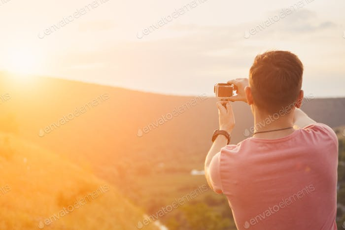 Young man smiling and enjoying sunny summer day