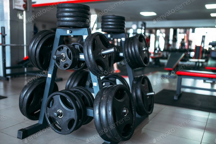 Weights for a bar, sport equipment in gym