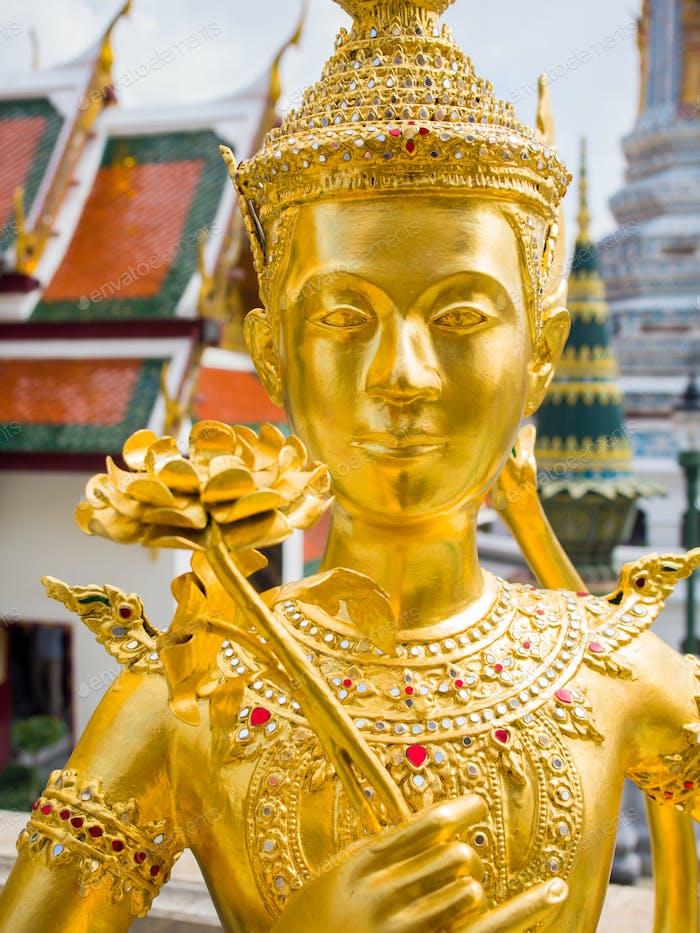 Kinnari statue at Wat Phra Kaew in Grand Palace, Bangkok.