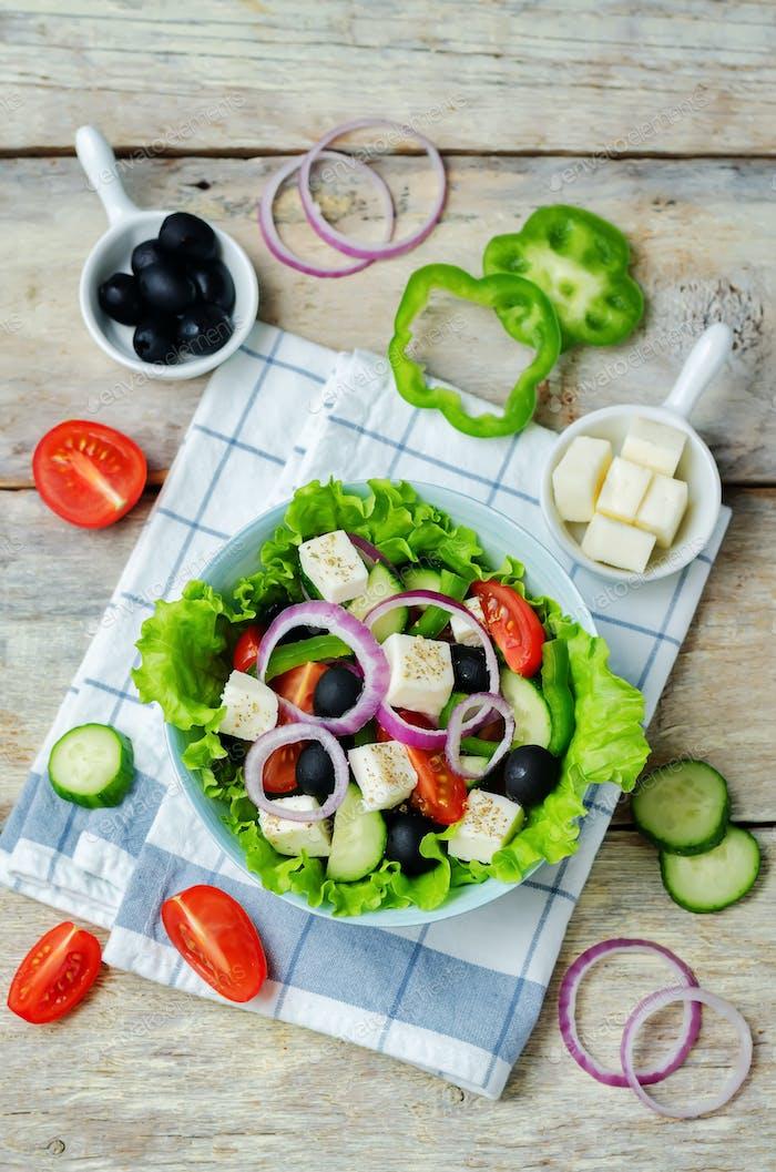 Greek Salad with ingredients to prepare it