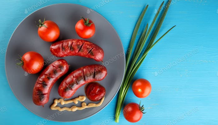 Amazing meat fried sausages with tomatoes and spices