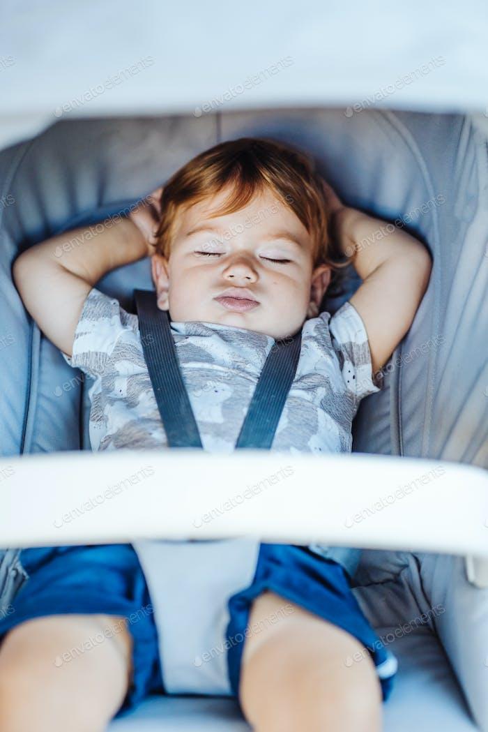 Little baby sleeping in a stroller.