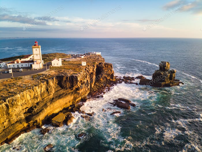 Lighthouse And Sea In Peniche Portugal
