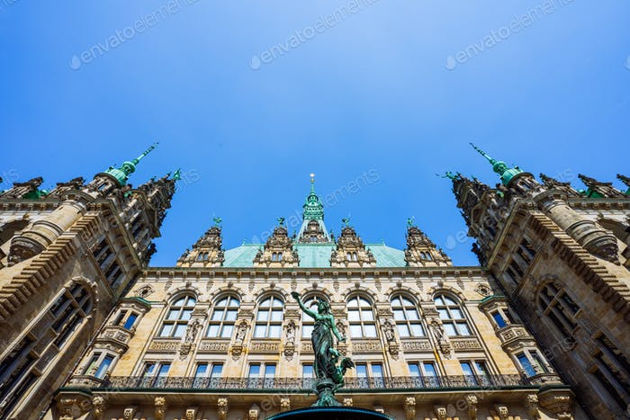 Roof shape view of the beautiful famous Hamburg town hall with Hygieia fountain from courtyard near