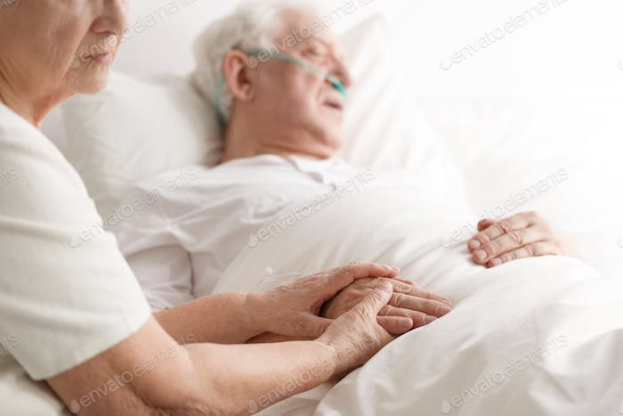 Dying senior man and his wife