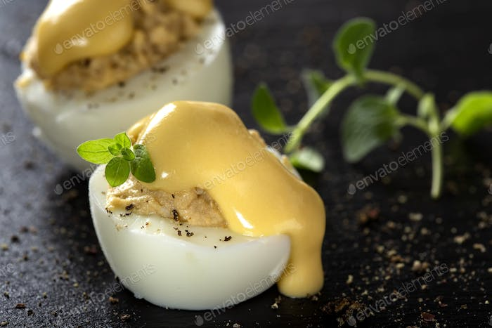 Stuffed eggs with pate and mayonnaise