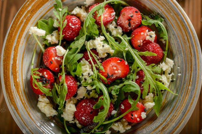 Vegetarian strawberry arugula and feta cheese salad with chia se