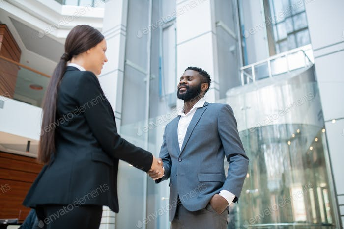 Congratulating colleague with successful contract