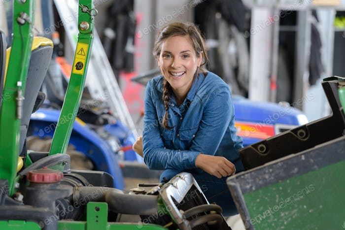 smiling woman in a mechanical workshop