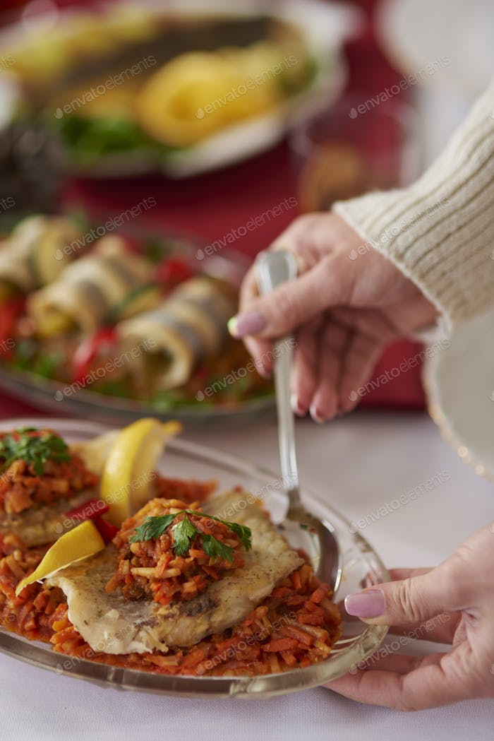 Taking greek style fish with silverware