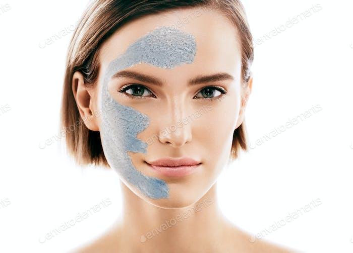 Woman spa mask black half-face beauty concept. Studio shot.