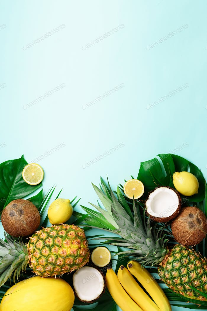 Exotic pineapples, ripe coconuts, banana, melon, lemon, tropical palm and green monstera leaves on