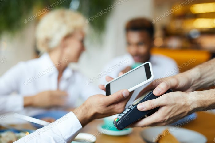 Putting smartphone on terminal for online payment