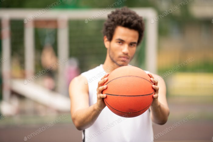 Hands of young contemporary active basketball player passing ball