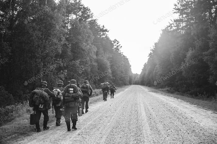 German Infantry Soldier In World War II Marching Walking Along F