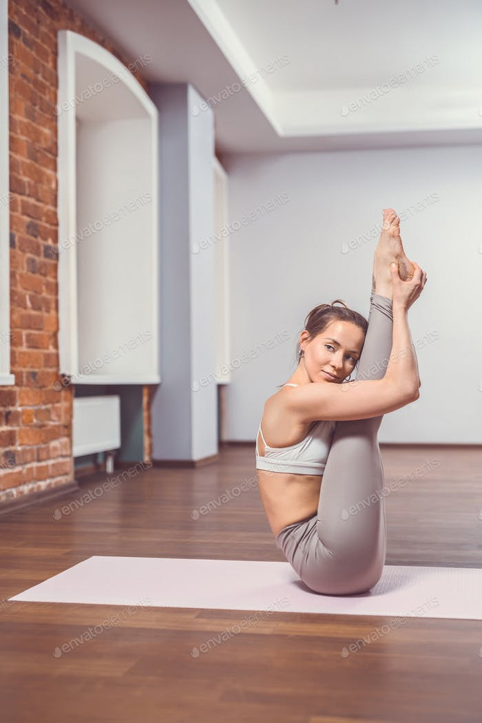Attractive woman in yoga class