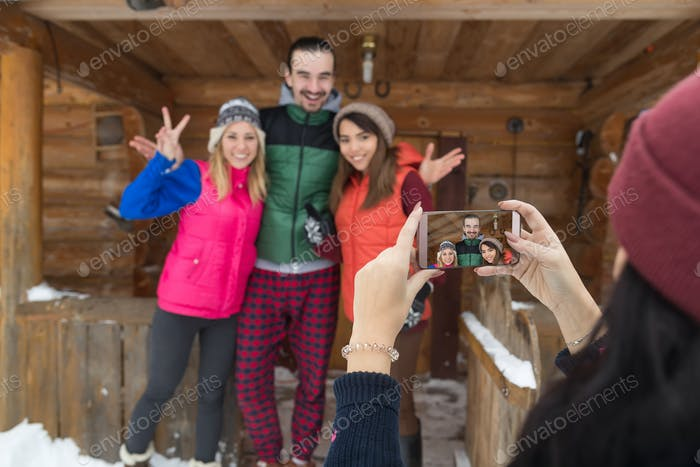 Girl Taking Photo On Smart Phone People Group Wooden Country Mountain House Winter Snow Resort