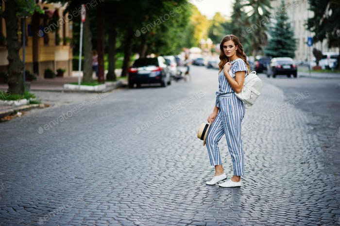 Young woman in striped overall