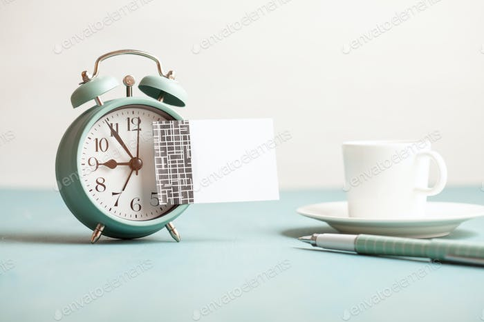 Mockup of retro style alarm clock with empty sticky note with copy space for text