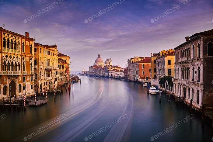 Long exposure of the Grand canal in Venice under cloudy blue sky