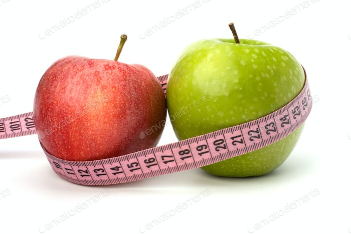Apple with tape measure. Healthy lifestyle concept.