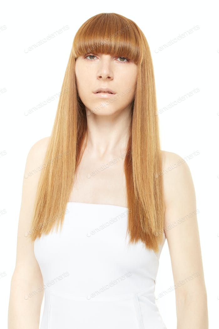 Blond hair. Young woman with long, straight hair with fringe on