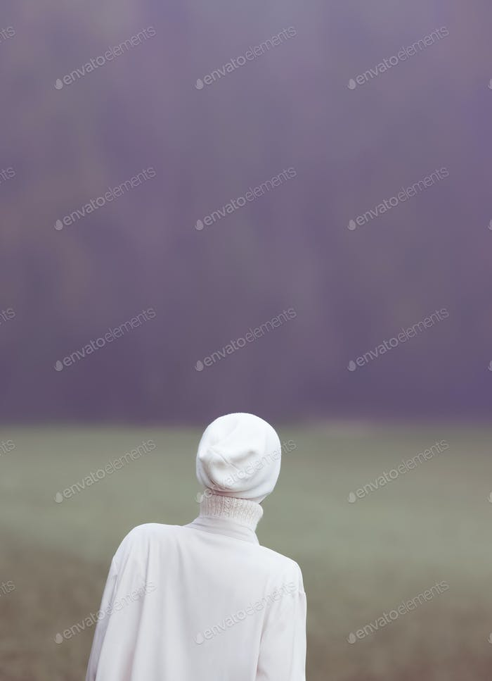 Glamour girl in a white dress in the woods. Loneliness and memor