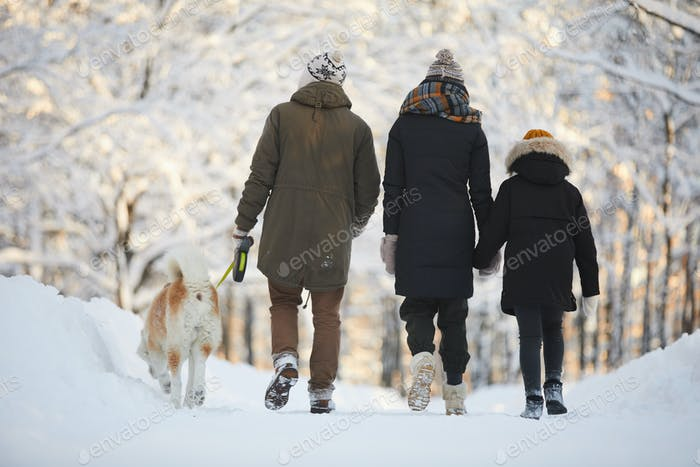 Family Walking with Dog in Park