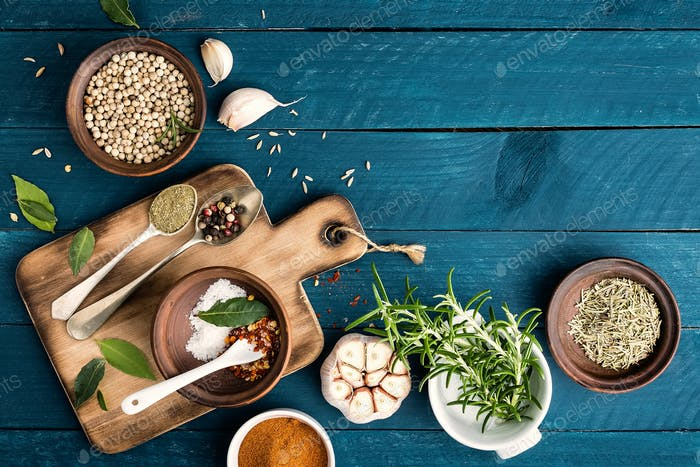 Thumbnail for culinary background with spices on wooden table