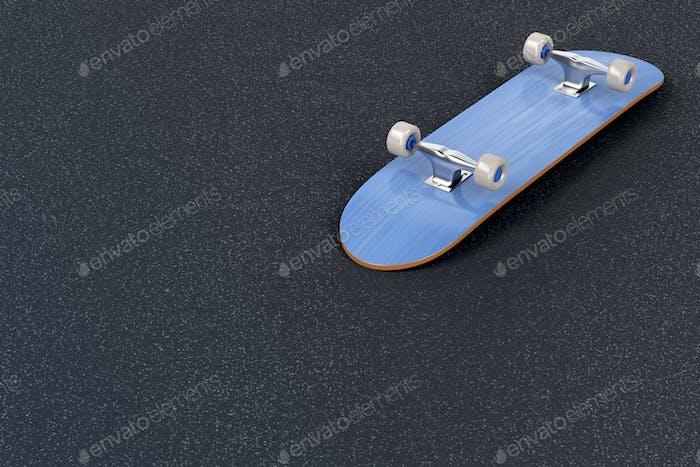 Skateboard on asphalt