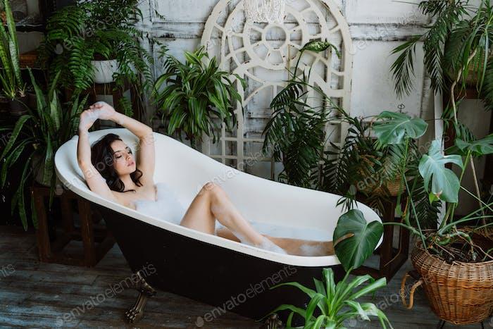 beautiful woman taking an hot bath in her countryside house