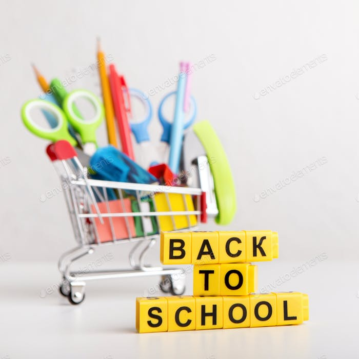 Back to school text with office supplies in shopping truck