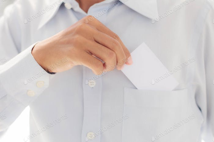 man holding card in pocket.