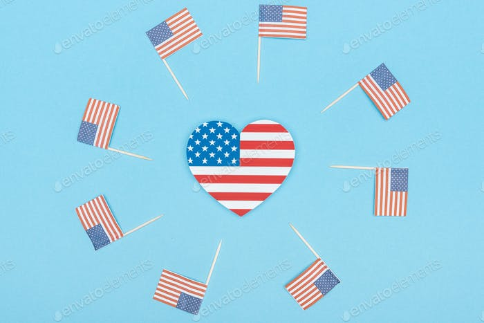 Paper Cut Decorative American Flags on Wooden Sticks