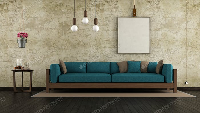 Living room with old wall and wooden sofa -