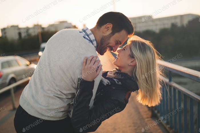 Romantic couple in love enjoying sunset