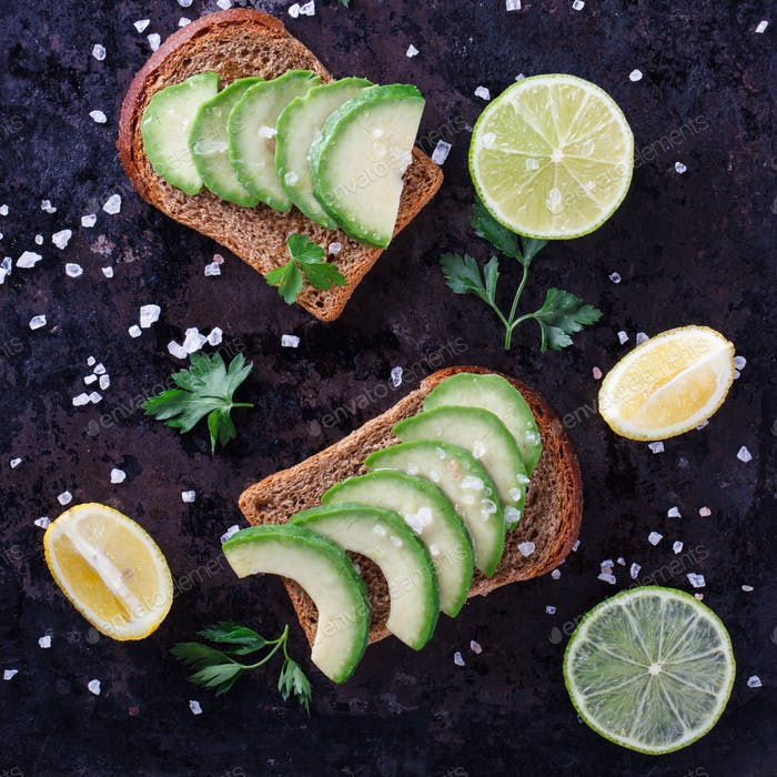 Toast with avocado on rye bread with parsley and salt