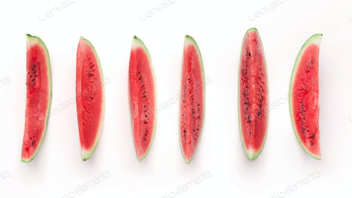 Row of fresh ripe watermelon pieces, isolated on white