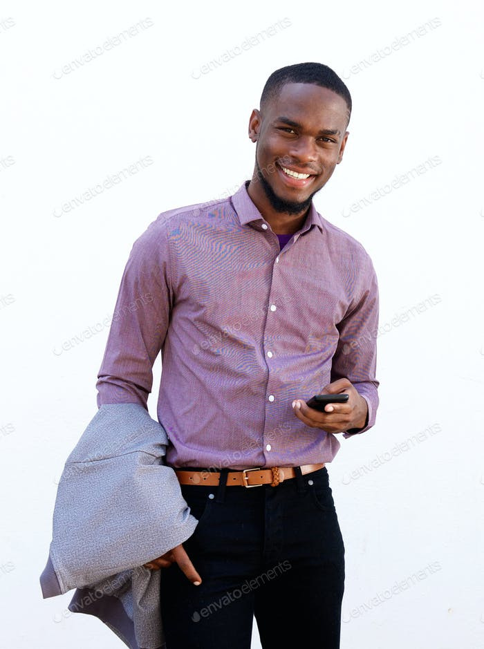 Handsome young man standing with a mobile phone