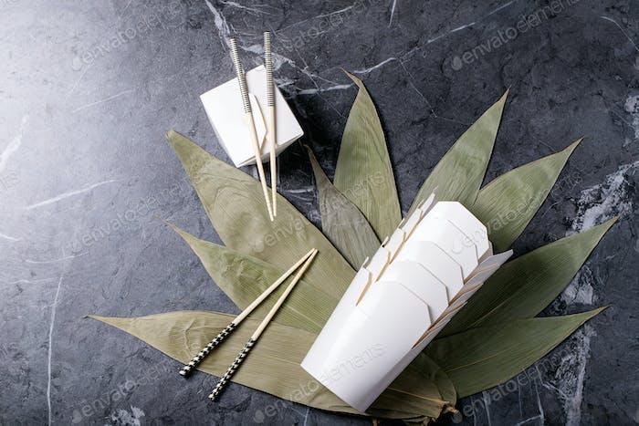 Bamboo leaves over dark background