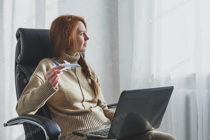 Woman dreaming about travel while self isolation at home