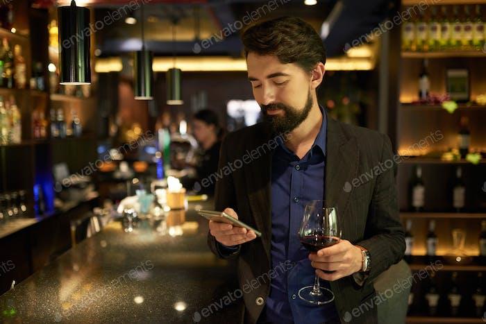 Man spending time in bar
