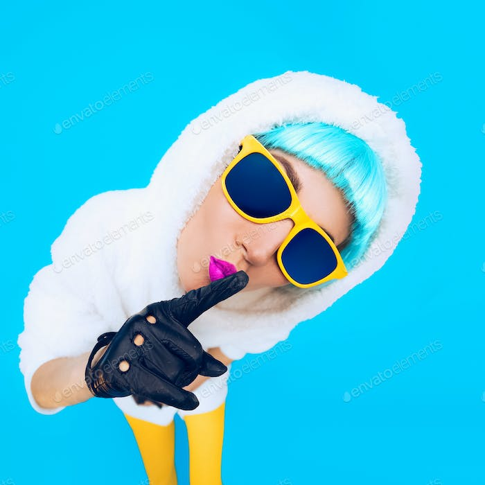 Guess fashion girl in a white hoodie on a blue background. Winte