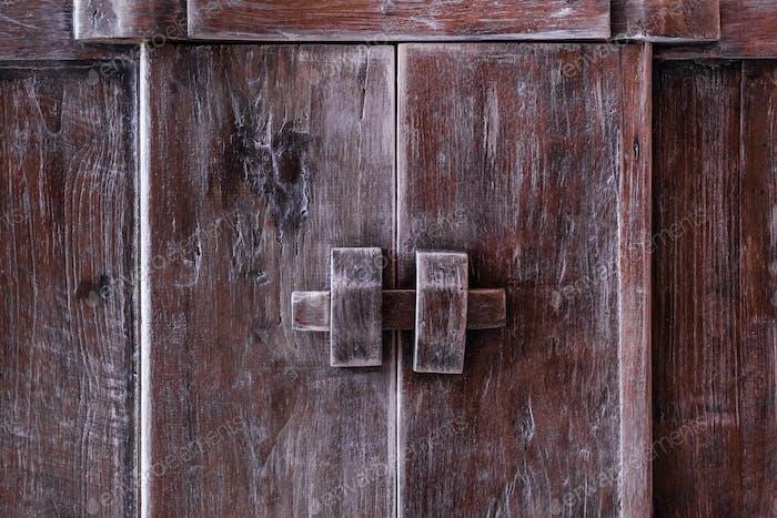 Vintage door knob on wooden antique door furniture
