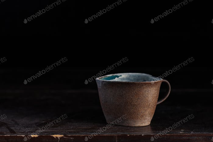 cups and dusty on wooden