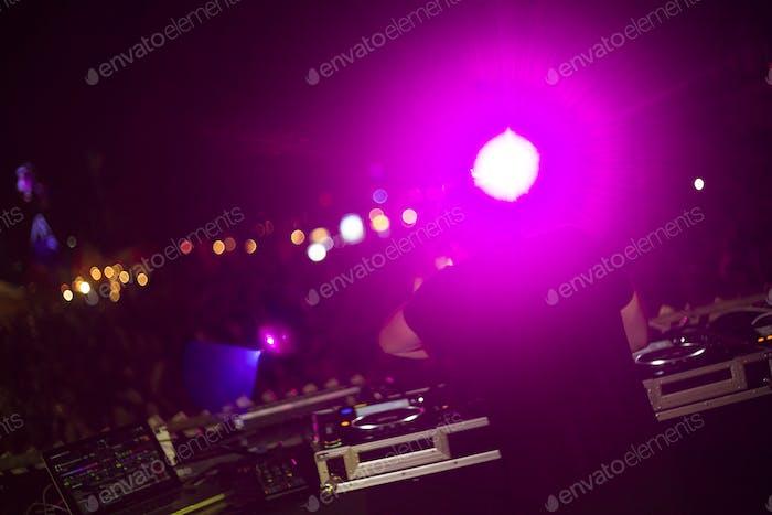 DJ Using Tuner Make Musics in Festival