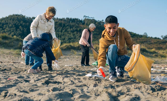Young man cleaning the beach
